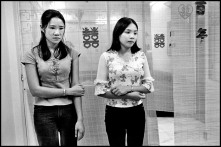 VIETNAM. Ho Chi Minh City. 2003. Recruited by marriage brokers, young Vietnamese women are viewed by Taiwanese men who-for a price-can pick and wed them within a few days.