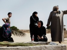 LIBYA. Janzour. 2011. A women cries over the grave of a man who died at the front line in Libya's victory.