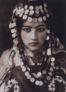 An Ouled Nail girl wears a dowry of gold coins.