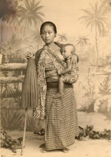 An informal portrait of a Javanese mother and her nursing child.
