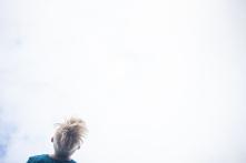 Husavik, Iceland,Luglio 2015 Particolare di un salto all' indietro dal trampolino di un ragazzo. A young boy jump.