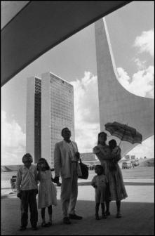 BRAZIL. Brasilia. 1960. Worker from Nordeste shows his family the new city on inauguration day. In the background: the National Congress building by Oscar NIEMEYER.