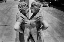 USA. New York City. 1969. Woman looking at herself in store window.